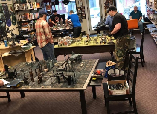 A great shot of the games going on, you can see me in the back playing against Mykah in the back table.