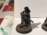 The Tanith 1st had an influx of recruits from the destroyed hive city of Vervunhive, a cosmopolitan place. As such, this Guardsman is painted with a slightly more olive skin tone.