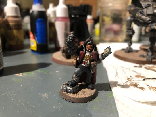 One of my favourite commissar models, reading the Uplifting Primer to his men, fist raised!